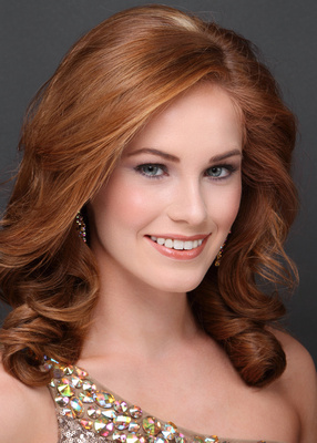 pageant headshot portrait teen female curled red hair smile